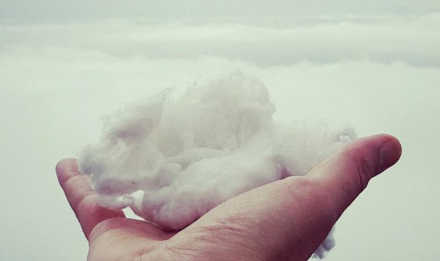 follow your dreams clouds in hand